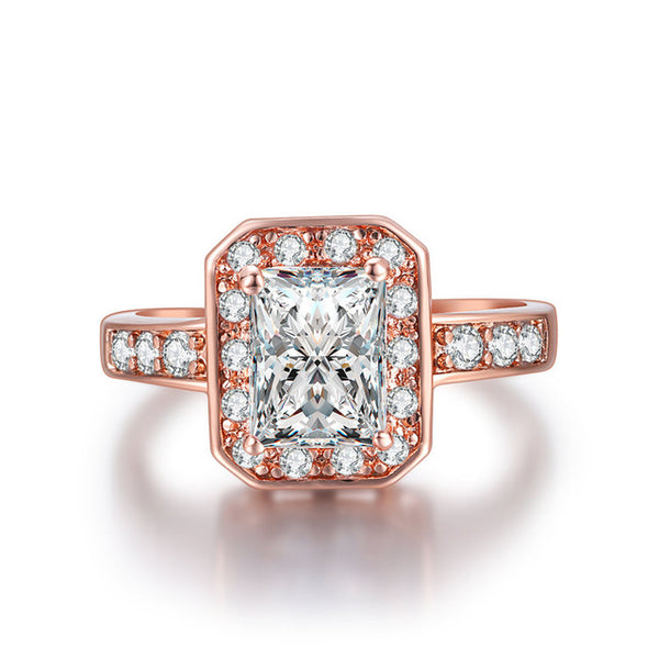 2 carat Radiant Simulated Diamond Halow Engagement Ring with Large Round Prong Set Side Stones in Rose Gold Band.