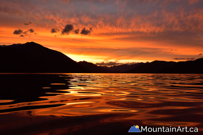 Slocan Lake sunset reflection, New denver, BC, Canada.
