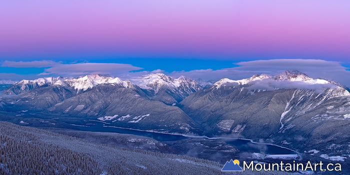 Alpenglow over rugged BC Purcell mountains Winter panorama
