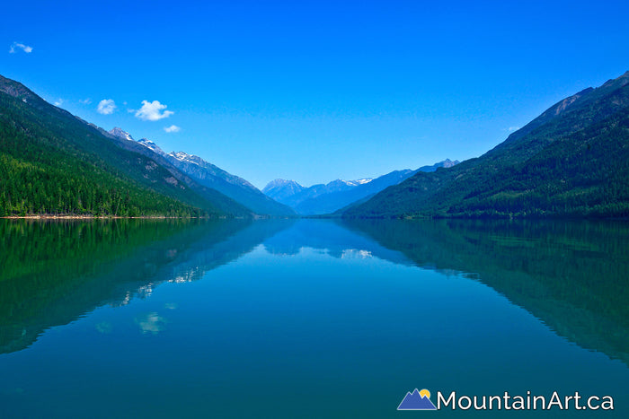 Upper Duncan Lake with Badshot mountains reflecting in glacial watersbc canada