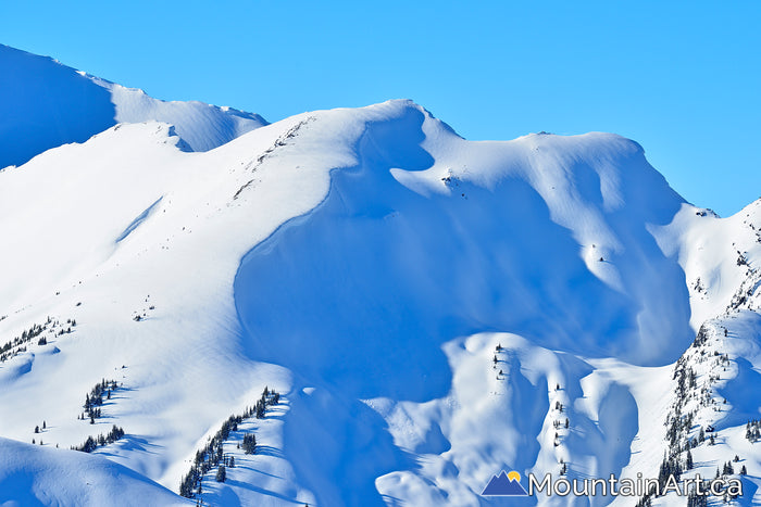 cornice covered ridges of the selkirk mountains in goat range park winter
