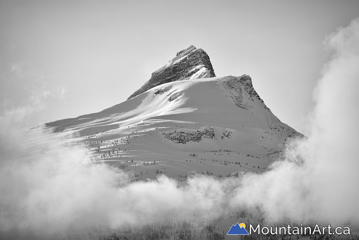 snow covered mt odin view from halcyon hotsprings in the monashee mountains