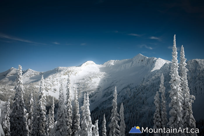Whitewater backcountry snow covered Ymir Bowl and Ymir Peak