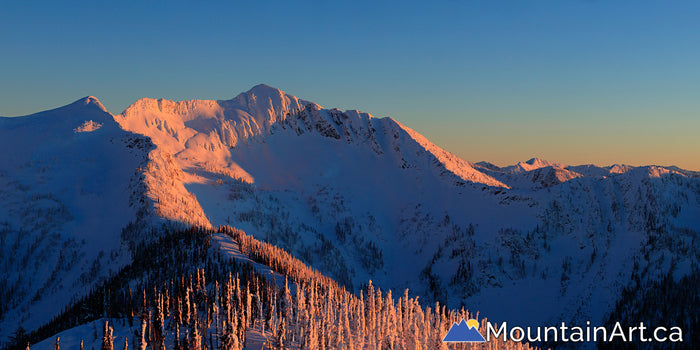 Ymir bowl sunset panorama with alpenglow whitewater ski Nelson BC