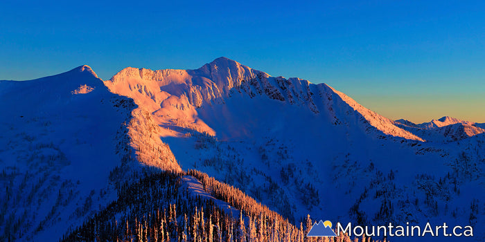 alpenglow sunset on Ymir Peak and Ymir Bowl panorama whitewater Nelson bc