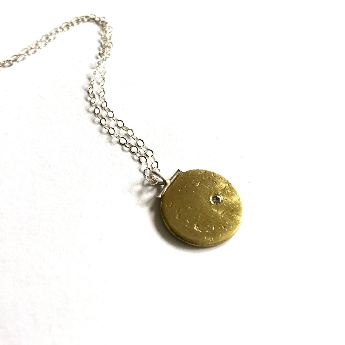 "Eko Wright:(S) Disc necklace with CZ in brass & sterling silver 5/8"" diameter 18"" long"