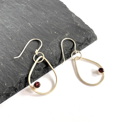 Eko Wright:(S) Teardrop earrings with garnet in sterling silver 1-1/2
