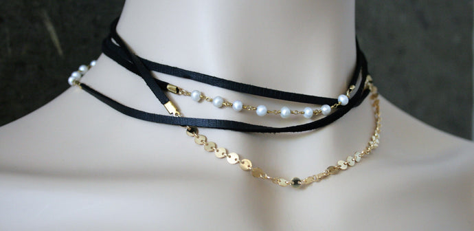 Judith Poe: Black Leather with Pearl Wrap