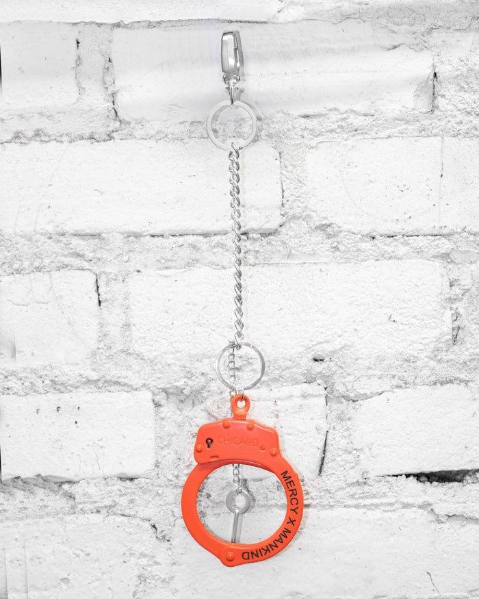 STEEL ENGRAVED HANDCUFF BRACELET/CHAIN (ORANGE)