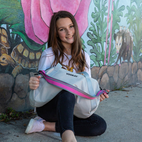 Girl with grey STRONG selfie duffle bag