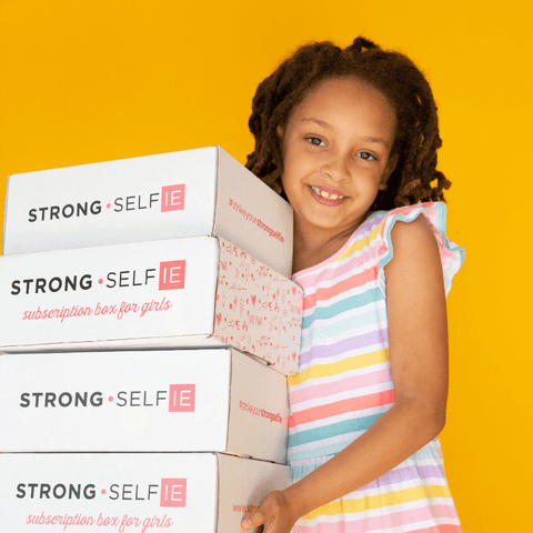 Tween girl holding Strong selfie boxes