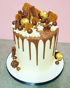 Extra Tall Vanilla Drip Cake With Chocolates