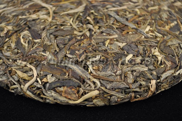 "2011 Yunnan Sourcing ""Jing Gu"" Ancient Arbor Raw Pu-erh Tea Cake"