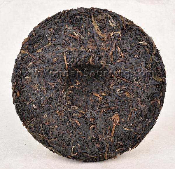 "2011 Yunnan Sourcing ""Yi Wu Purple Tea"" Raw Pu-erh Tea Cake"
