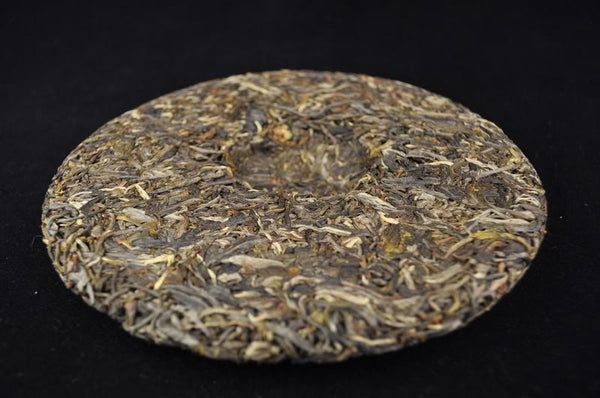 "2012 Yunnan Sourcing ""Mang Fei Mountain"" Wild Arbor Raw Pu-erh Tea Cake"