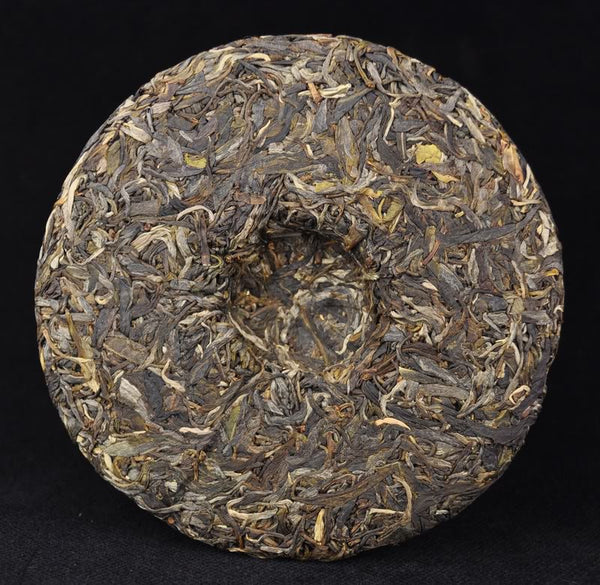 "2012 Yunnan Sourcing ""Man Zhuan"" Raw Pu-erh Tea Cake of Yi Wu"