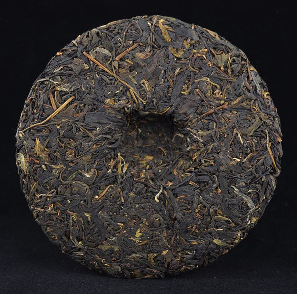 "2013 Yunnan Sourcing ""Yi Wu Purple Tea"" Raw Pu-erh Tea Cake"