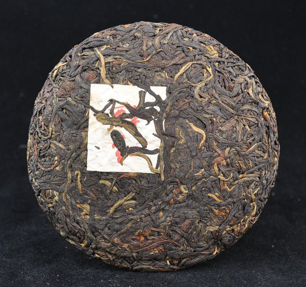 "Spring 2013 ""Drunk on Red"" Sun-Dried Feng Qing Black Tea mini cake"