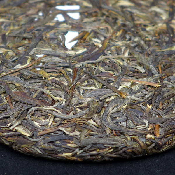 "2014 Yunnan Sourcing ""Autumn Mi Bu"" Ancient Arbor Raw Pu-erh Tea Cake"