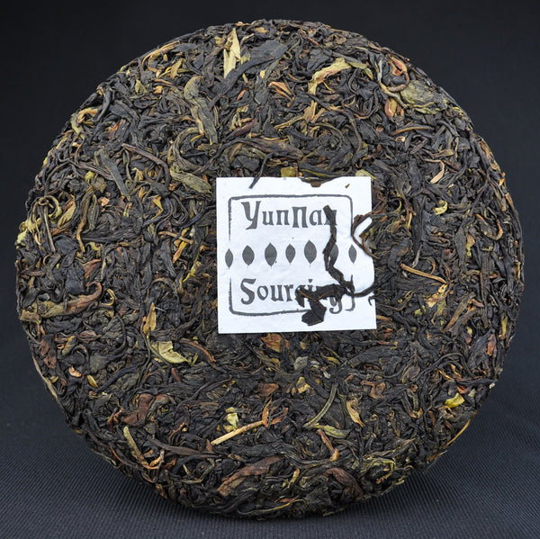 2015 Yunnan Sourcing Dehong Ye Sheng Cha Wild Tree Purple Tea cake