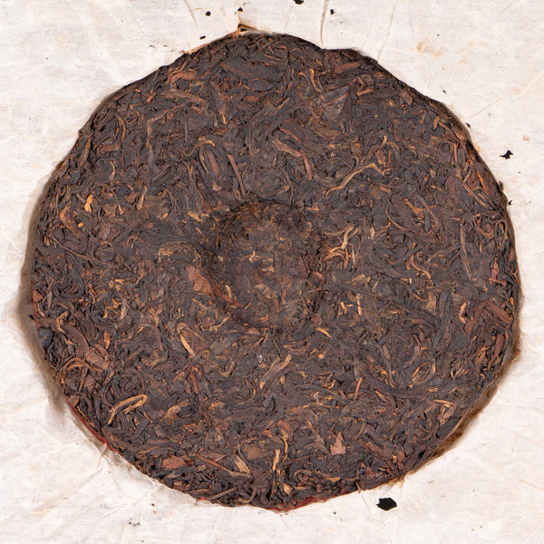 "1999 ""Artistic Font"" Yi Wu Mountain Raw Pu-erh Tea Cake"