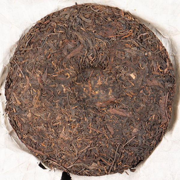 1999 White Cotton Paper Yi Wu Raw Pu-erh Tea Cake