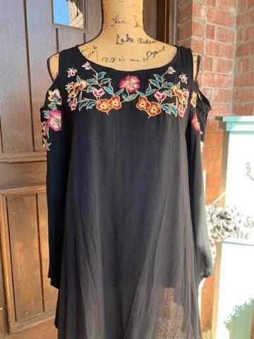 Black embroidered off the shoulder shirt