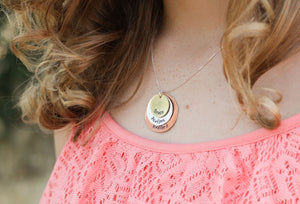DELENA CIASTKO DESIGNS, hand stamped custom jewelry, stamped necklace modeled on woman