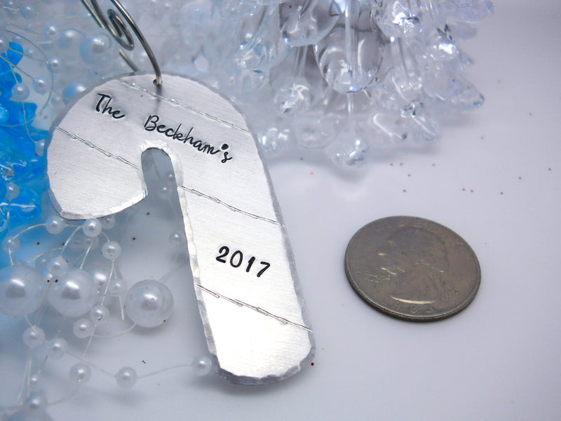 Personalized Candy Cane Christmas Ornament, size comparison to a quarter