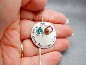 Sterling Silver Personalized Mom Necklace with Kids Names, modeled in hand