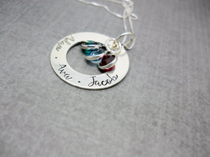 Sterling silver personalized Mothers washer necklace with kids names, flat lay