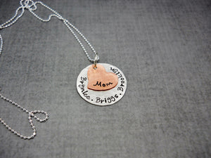 Sterling Silver and Copper Custom Mothers Necklace With Kids Names, flat lay