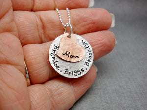 Sterling Silver and Copper Custom Mothers Necklace With Kids Names, modeled in hand