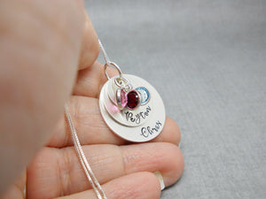 3 Layered Sterling Silver Mom Necklace with Kids Names, held in hand