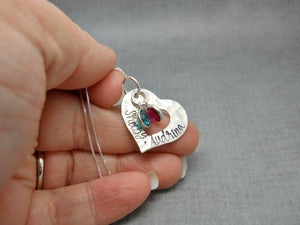Custom Textured Sterling Silver Personalized Heart Necklace with Kids Names, held in hand