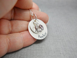 Double Stacked Sterling Silver Personalized Mom Necklace with Kids Names, held in hand