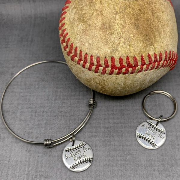 batting for Brock fundraiser bracelet and keychain