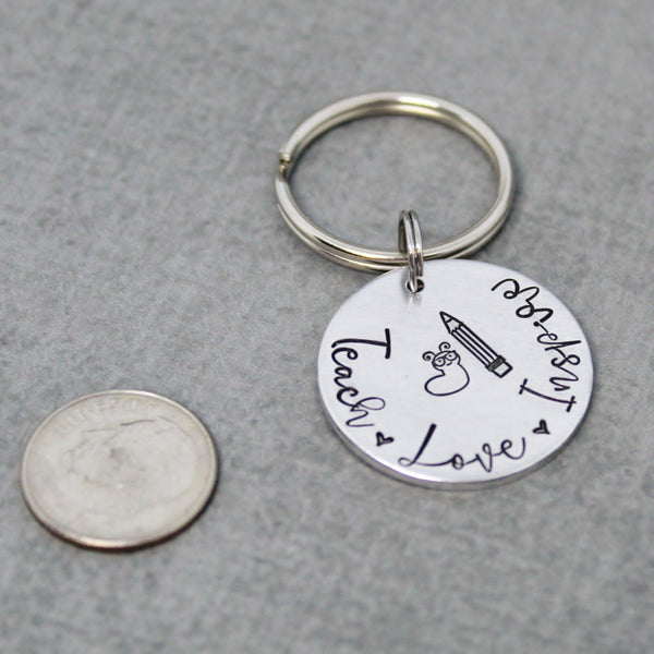Love Teach Inspire key chain - size comparison dime