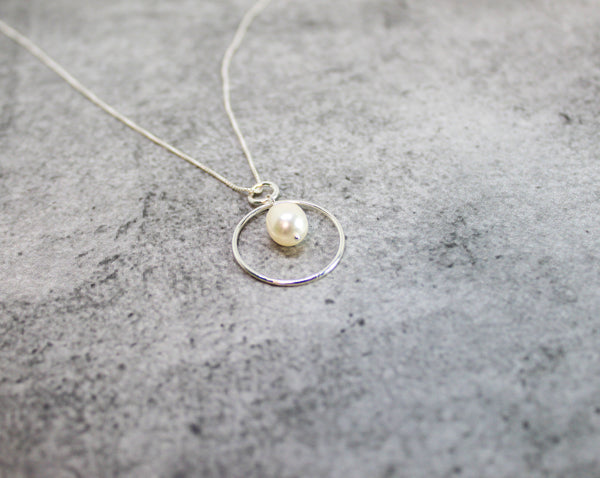 Sterling silver circle and pearl necklace