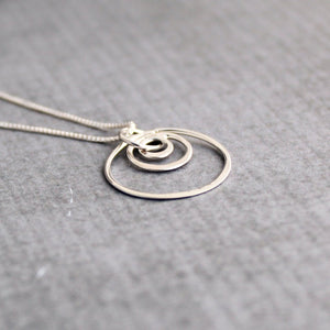 Sterling silver triple circles geometric minimalist necklace | side view