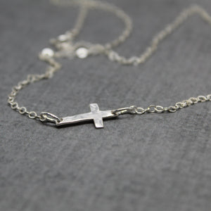 Sterling silver hammered sideways cross necklace