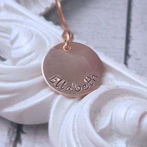 Personalized Rose Gold Mothers Necklace with Kids Name, flat lay over a frame