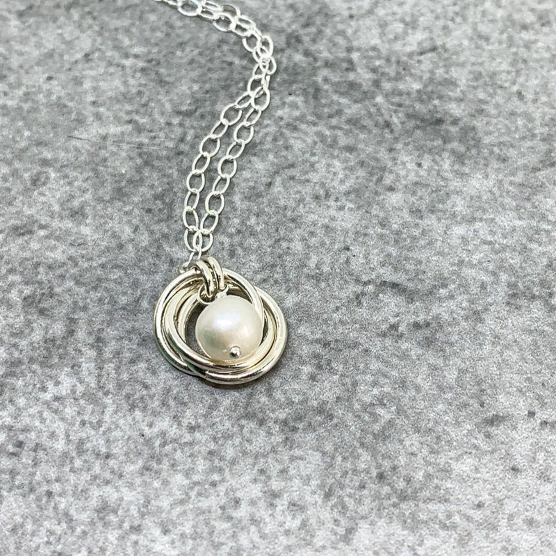 Sterling silver interlocking circles and white pearl bridesmaid necklace, Mobius knot necklace