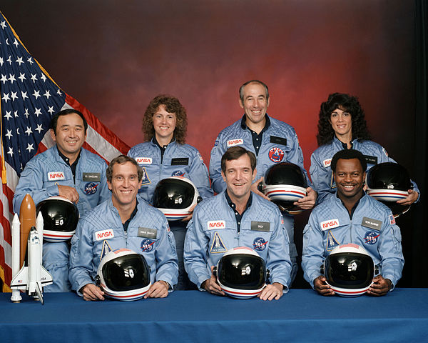 """Challenger flight 51-l crew"" by NASA - NASA Human Space Flight Gallery (image link). Licensed under Public Domain via Commons - https://commons.wikimedia.org/wiki/File:Challenger_flight_51-l_crew.jpg#/media/File:Challenger_flight_51-l_crew.jpg"