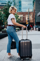 Woman wearing stretch belt with suitcase