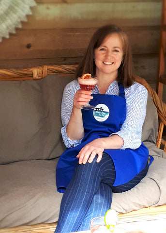 Mara Parnell smiling and saying cheers with a mocktail in her hand