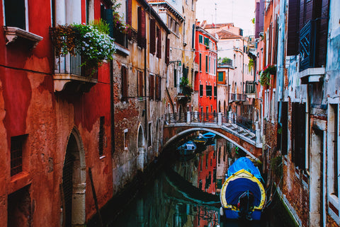 A Venetian canal drenched in red