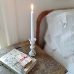 Our Antique White Taper Candle Holder features romantic curves and an aged, rusted finish for that chippy white paint look that is familiar to today's vintage farmhouse style. They are perfect for adding a bit of shabby chic flair to any tabletop or bedside table. Made of metal with a distressed ivory finish.