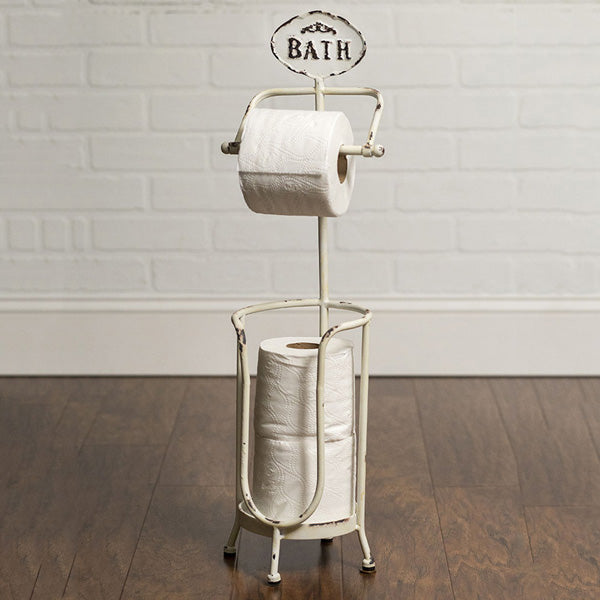 "Create a vintage style bathroom with our Antique White Toilet Paper Stand. Made of metal and can accommodate three rolls of toilet paper, with one-on-the-ready to use spindle and two conveniently stacked below. An enamel style ""Bath"" sign tops off this quaint stand. Measures 7½""W x 7½""D x 25""H."