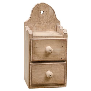 Our Antique Cream Two-Drawer Shelf is a sweet storage solution for small keepsakes. Its rustic finish makes it perfect for any room in your farmhouse. We like to keep one by the chalkboard with extra chalk stashed away. It's also great to store tea bags and other small items. Features a wooden shelf that includes two drawers for convenient organization. Shelf includes a pre-drilled hole so that it can be hung on the wall, or it can also be displayed tabletop.